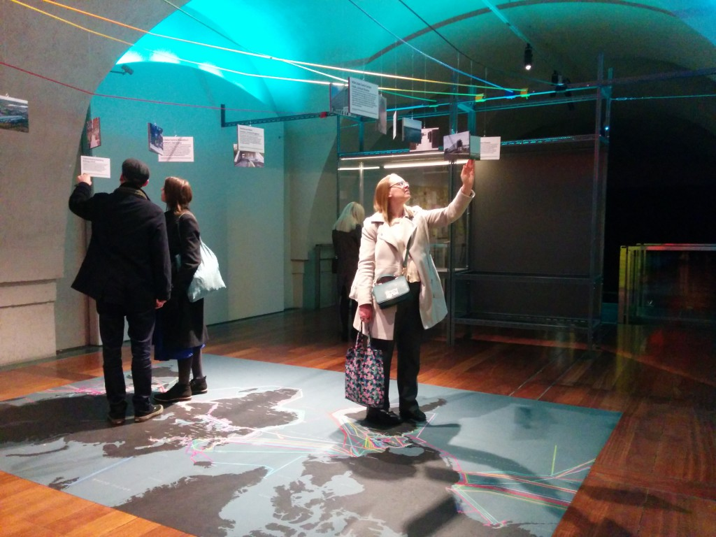 Woman exploring undersea fibre map installation