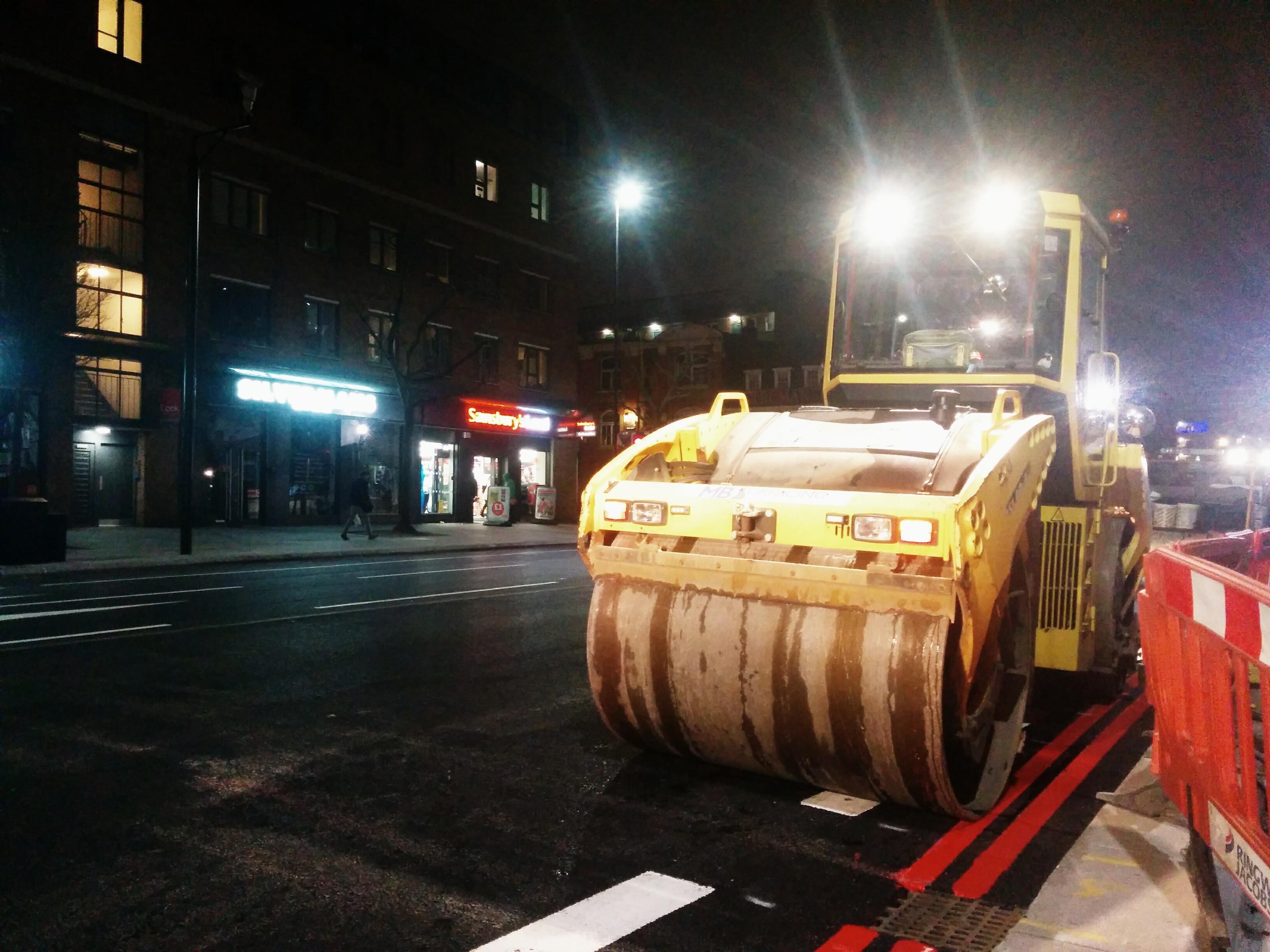 Road surface machinery at night Stepney Green
