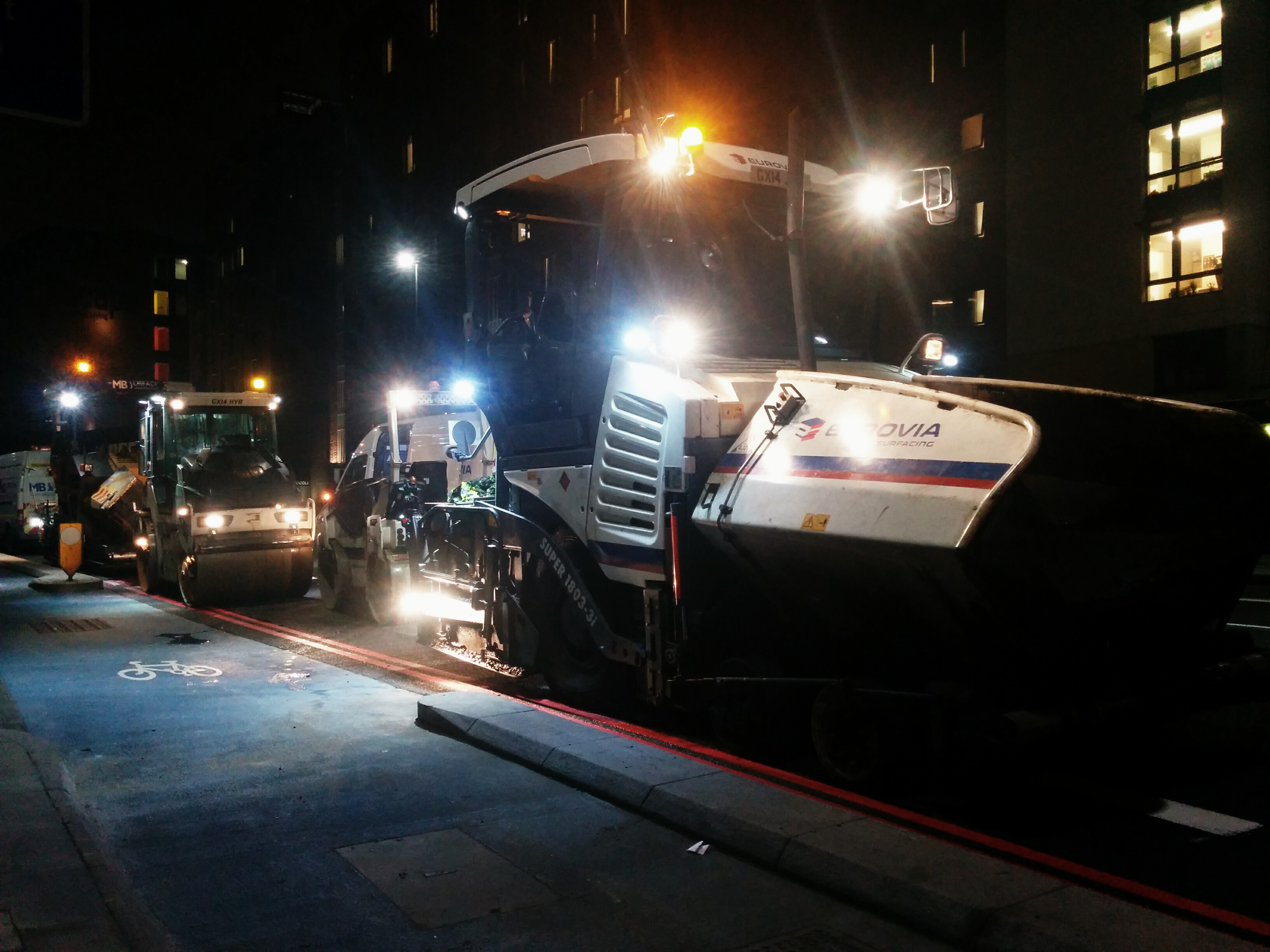 Road surface machinery at night Stepney Green