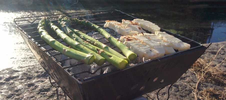 A photo of our BBQ by the canal in East End London. It is a sunny day. The BBQ is on the edge of the canal.