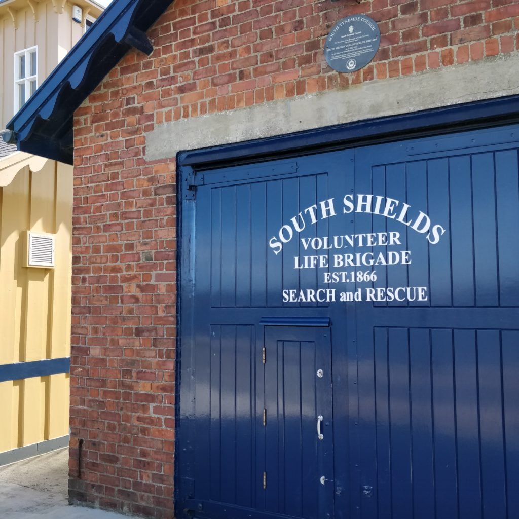 A picture of the blue boat house door of South Shields Volunteer Life Brigade, located on the pier in South Shields